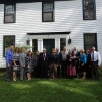 Joseph Smith Sr. Family Association members along with Dr. LeRoy Wirthlin and his wife, Mary, at the Smith home in Norwich, Vermont. Left to right: Daniel & LuAnn Adams, Steve & Frances Orton, Mary & LeRoy Wirthlin, Rosemarie & Dan Larsen, Michael Kennedy, Joyce & Karl Anderson, Julie Maddox, and Laura & Don Blanchard. Picture by Elder Michael Lantz